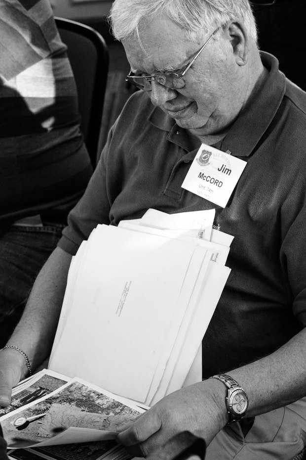 I could not tell if he was happy or about to cry as he looked at the photographs from the Vietnam War.